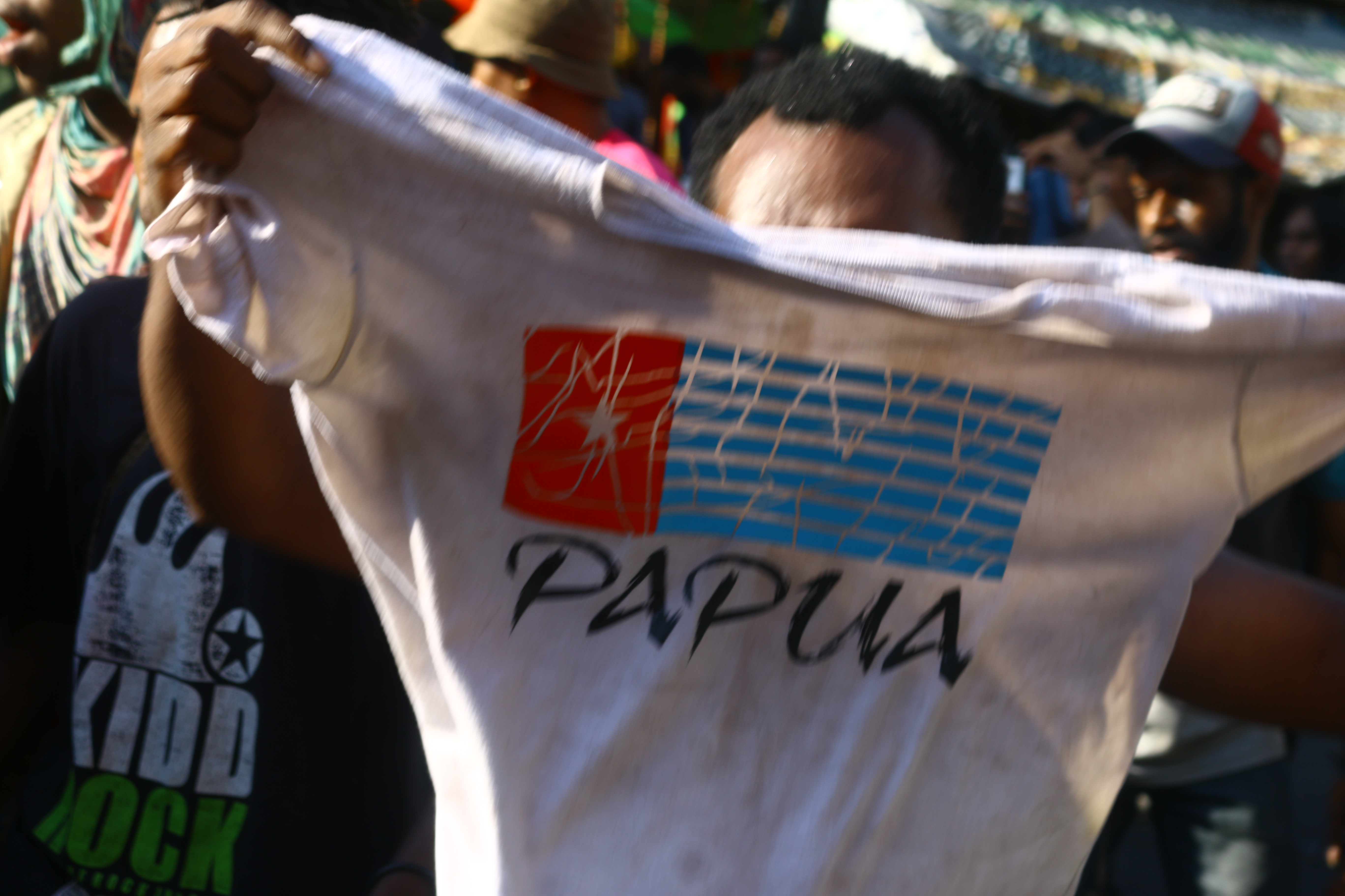 A participant ran while spreading a T-shirt with the Morning Star flag on it.